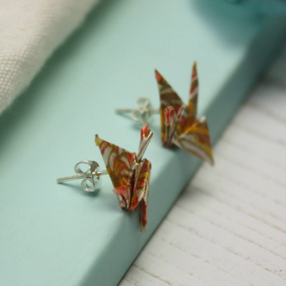 Salmon pink crane earrings, by the origami boutique.