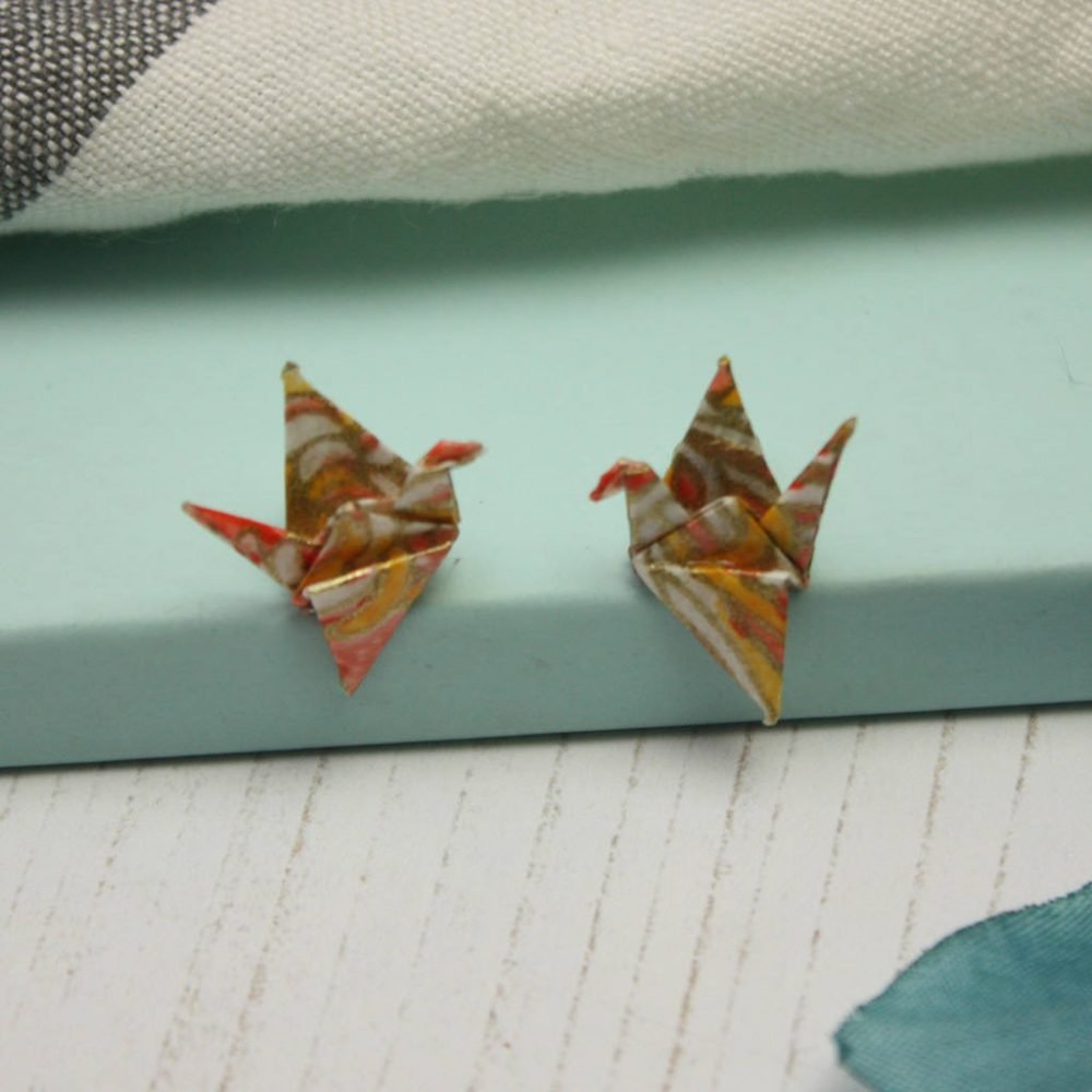 Salmon pink crane earrings,folded by the origami boutique.