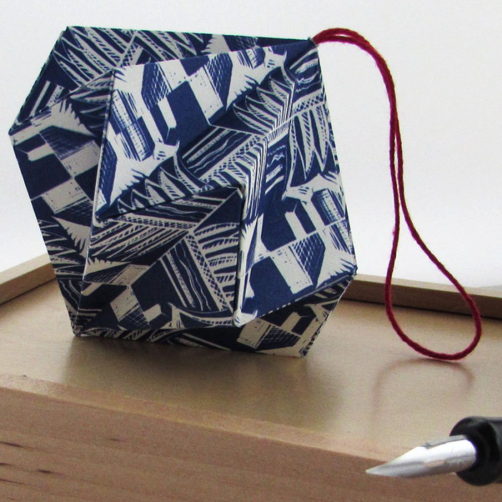 Blue and white scandi pattern diamond origami ornament. Handmade by the origami boutique.