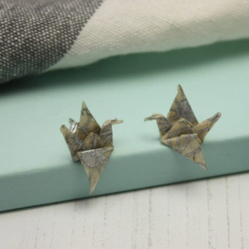 silver geometric pattern on natural paper. Small crane stud earrings for a comfortable unique wear. Handmade at the origami boutique.