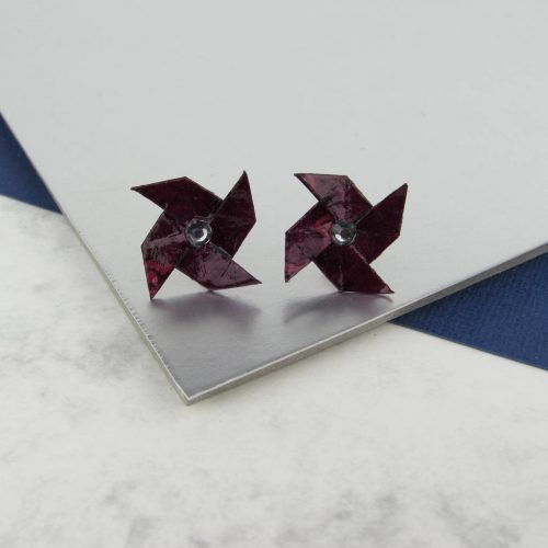 Maroon origami pinwheel earrings, handmade by the origami boutique, London.