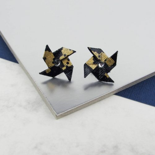 Black and gold origami pinwheel stud earrings, with rhinestones. Hand folded by The Origami Boutique, London.