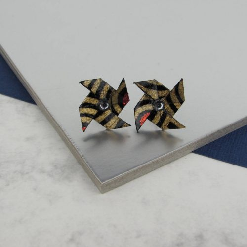 Origami pinwheel earrings, in black and metallic gold, with rhinestone, by the origami boutique.