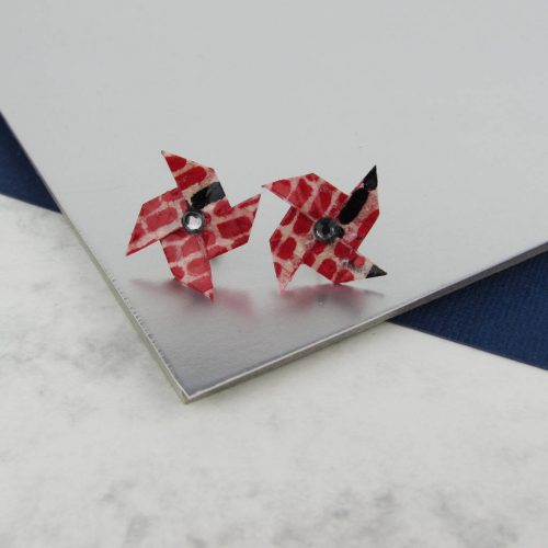 Washi paper pinwheel earrings in red and black pattern with rhinestone centre. The origami boutique.