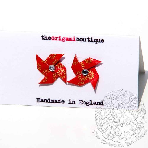 Red and gold pinwheel stud earrings with rhine stone centre, by the origami boutique. .