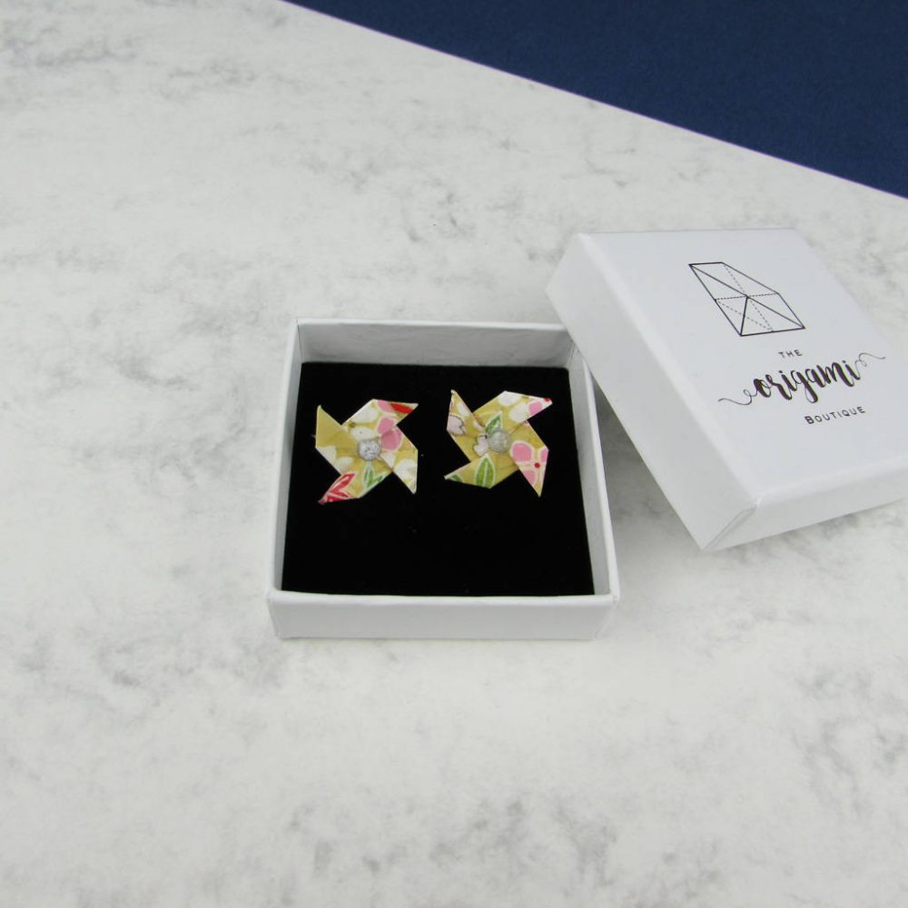 Yellow pinwheel summer earrings, by the origami boutique, london.