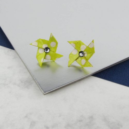 Yellow and white polkadot pinwheel earrings with rinestone centre. By the origami boutique.