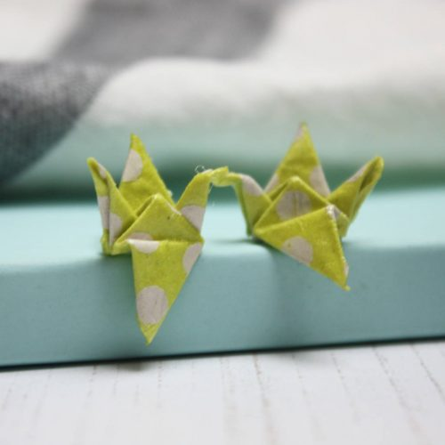 Yellow and white polka dot crane earrings, by the origami boutique, London.