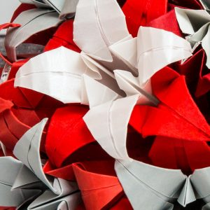 Close up of silver, red, and white origami wedding bouquet. Handmade by the origami boutique, London.